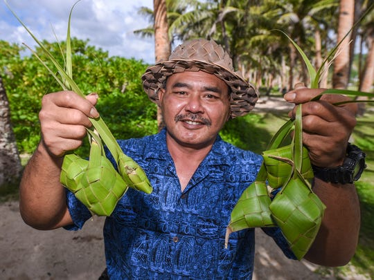 Chamorro teacher and weaver Joe Dågu Babauta holds up a collection of kåtupats, rice baskets, woven with leaves of the niyok, or coconut, tree while at the War in the Pacific National Historical Park's Asan Beach Unit on Wednesday, July 19, 2017.