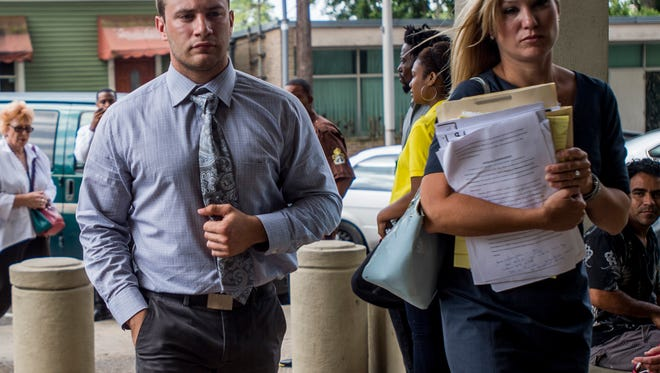 Seth Fontenot, far left, is escorted by his attorneys into the Lafayette Parish Courthouse in downtown Lafayette, La., prior to his sentencing hearing on Wednesday, July 8, 2015. Fontenot was convicted of manslaughter and two counts of aggravated in the February 2013 shooting death of Austin Rivault and injury of Cole Kelley and William Bellamy