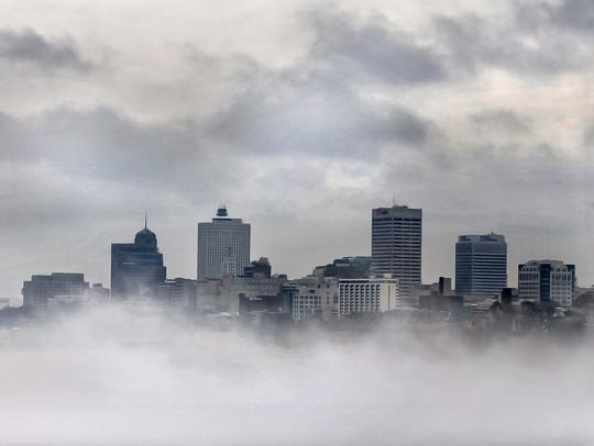 The Memphis skyline emerges from the fog as it is burned away Wednesday morning February 8, 2017 viewed from the Big River Crossing.
