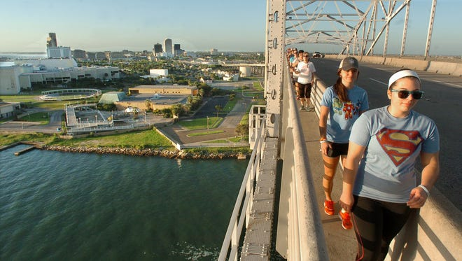 walkers participating the monthly walk across the harbor bridge and back take in some beautiful scenery of our city and port.  This month some also wore their superhero shirts.