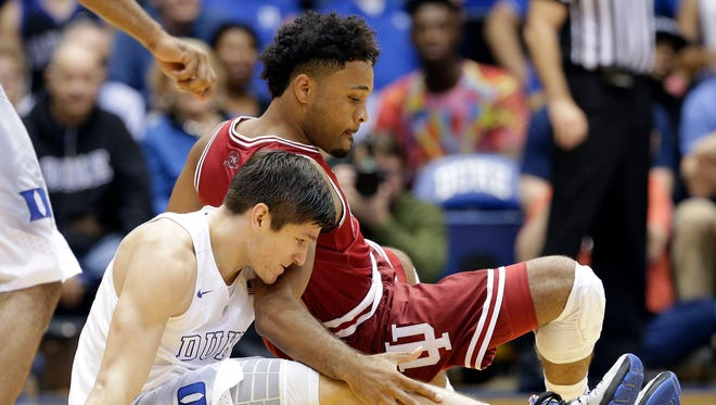 Duke's Grayson Allen falls to the floor with Indiana's James Blackmon Jr. during the second half of an NCAA college basketball game in Durham, N.C., Wednesday, Dec. 2, 2015. Duke won 94-74.