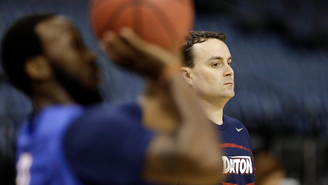 Dayton coach Archie Miller keeps an eye on his Flyers as they worked out in Memphis on Wednesday ahead of Thursday's game with Stanford. <cutline_credit>AP/Mark Humphrey</cutline_credit>