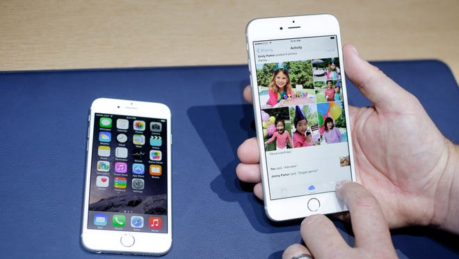 The iPhone 6, at left, and iPhone 6 plus are shown next to each other during a new product release in Cupertino, Calif. Apple had more than 4 million advance orders of its new iPhones in the first 24 hours, exceeding its initial supply, the company said Monday. The new phone debuted on Sept. 9 with no mention of sapphire cover glass.