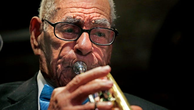 In a Wednesday, July 17, 2013 file photo, Dixieland jazz musician Lionel Ferbos performs at his 102nd birthday party at the Palm Court Jazz Cafe in New Orleans. Lionel Ferbos died today at his home in New Orleans, according to a family friend. He was 103. (
