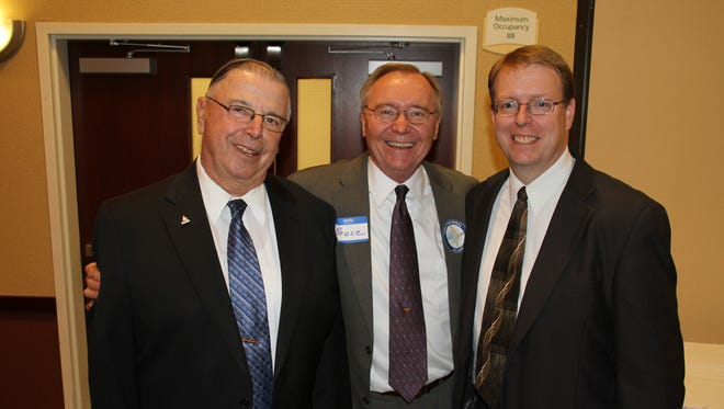 Iowa Fraternal Alliance President Bruce Maurer, center, congratulates state Rep. Henry Rayhons, left, state Sen. Rob Hogg for receiving awards in September, 2013.