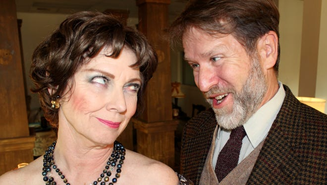 "Kim Grimaldi and Mark Gruber star as Martha and George in Repertory Theater of Iowa's staging of ""Who's Afraid of Virginia Woolf?"" at the Des Moines Social Club."