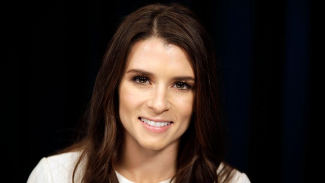 FILE - This Jan. 16, 2014 file photo shows NASCAR driver Danica Patrick poses for a picture in New York.
