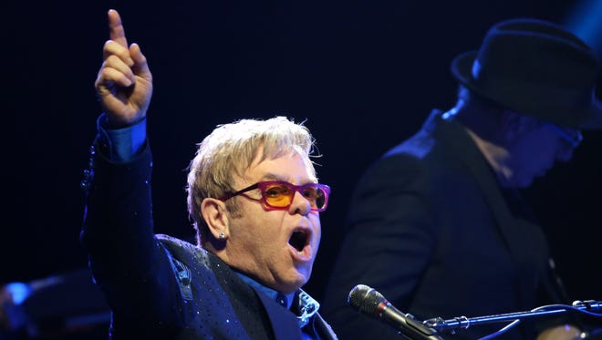 British singer Elton John performs during a concert at the Olympia concert hall in Paris on December 10, 2013.