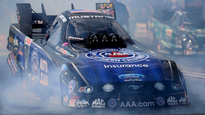 Smoke comes out the front of the car of NHRA funny car driver Robert Hight as he comes to a stop following his burnout during qualifying for the Lucas Oil Nationals at Brainerd International Raceway.
