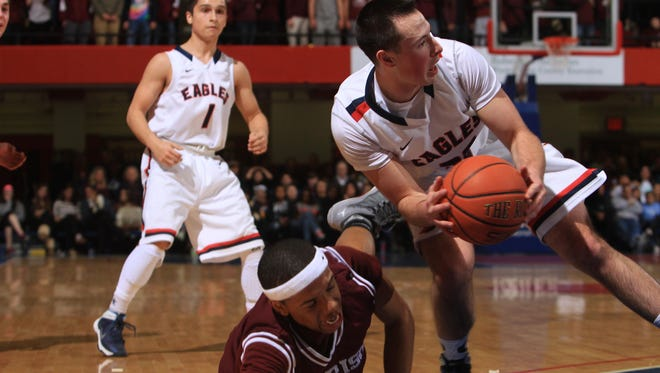 From right, Eastchester's Michael Milo (32) wins the battle for a loose ball with Harrison's Tyrel Brown during the Class A boys basketball semifinal basketball game at the Westchester County Center in White Plains Feb. 26, 2014.