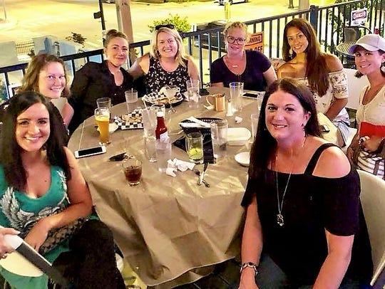 Rooftop Fun -  Longtime friends (from L) Katie Kelley,