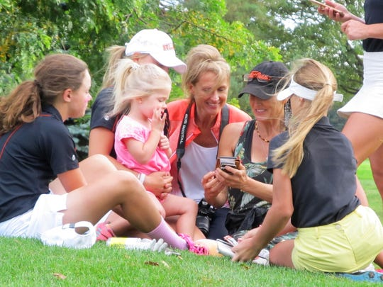 Brighton golf mother Sarah Pietila (black hat) shows