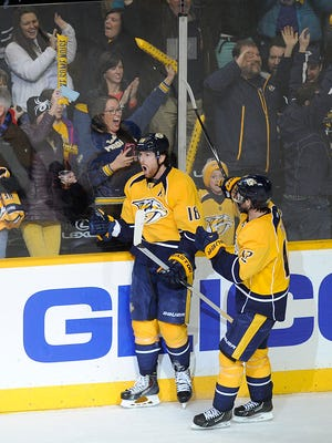 The Predators' James Neal (18) celebrates after scoring the eventual winning goal in the third period Friday.