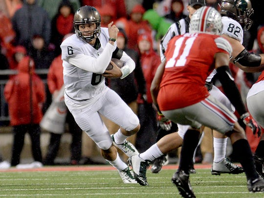 Spartan quarterback Damion Terry looks for a running