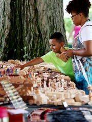 Tabitha Brown and her son Tavion of Waynesboro visit a craft table at the Waynesboro Summer Extravaganza on Saturday, July 11, 2015 at Ridgeview Park. Brown said that coming to the Extravaganza has become a family tradition.
