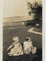 Perry Deane Young, left, as a toddler in front of the