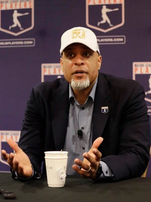 Executive director of the Major League Players Association Tony Clark answers questions at a news conference Sunday.