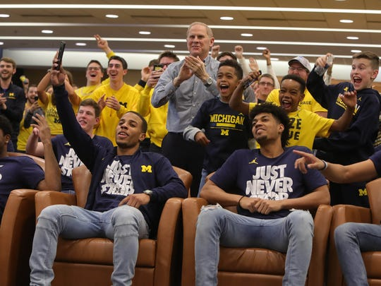 Michigan head coach John Beilein and his players react after finding out U-M's NCAA tournament opponent on Sunday, March 11, 2018, in Ann Arbor.