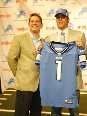Lions coach Jim Schwartz, left, and No. 1 pick overall, QB Matthew Stafford, during a photo opportunity and press conference at their Practice Facility in Allen Park on April 26, 2009. JULIAN H. GONZALEZ/Detroit Free Press