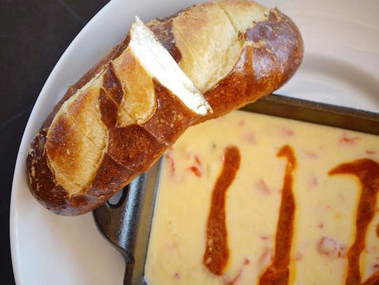 Dunk your soft pretzel in Asiago fondue at Wally's.