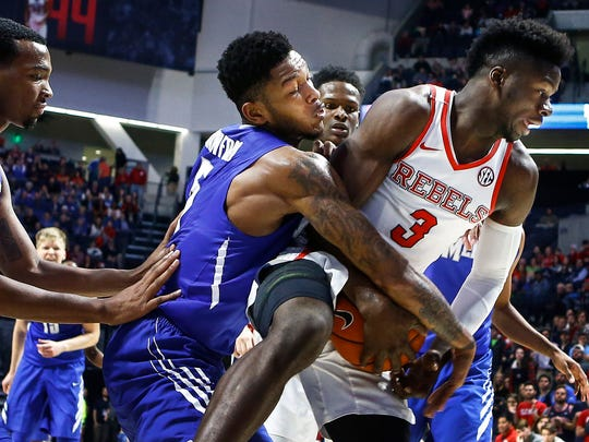 University of Memphis guard Markel Crawford (left) is called for his fourth foul after reaching for a rebound against Ole Miss forward Terence Davis (right) during second half action at The Pavilion in Oxford, Mississippi.