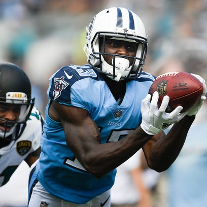 Titans wide receiver Taywan Taylor (13) pulls in a