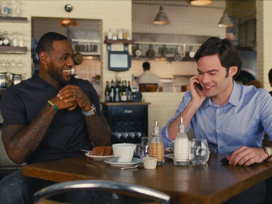 "LeBron James, left, as himself, and Bill Hader as his best friend, Aaron, in ""Trainwreck."""