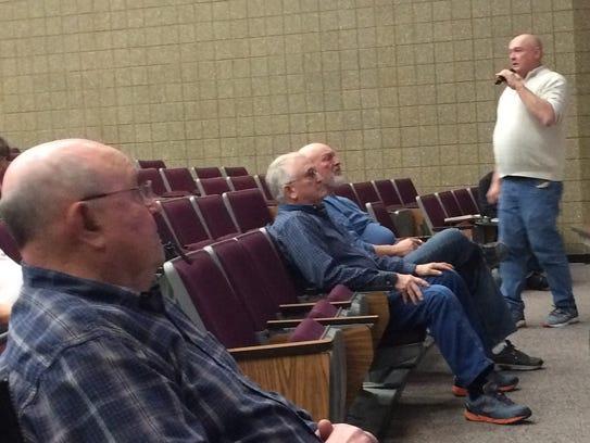 Gardner Town Chairman Jon Koch, standing, presents