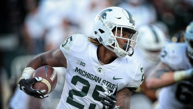Michigan State, in its all-white uniforms, rolled to 2-0 on Saturday against Western Michigan.