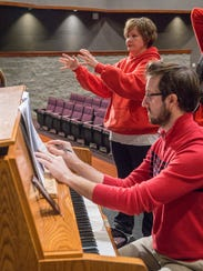 Accompanist Justin Umbarger and director Tracy Spada