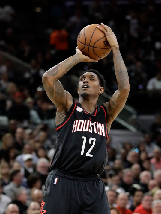FILE - In this May 9, 2017, file photo, Houston Rockets' Lou Williams (12) attempts a shot during the first half in Game 5 of an NBA basketball second-round playoff series against the San Antonio Spurs, in San Antonio. The Houston Rockets have reached an agreement to trade for Los Angeles Clippers point guard Chris Paul according to a person familiar with the deal. The league source spoke to The Associated Press on Wednesday, June 28, 2017, on the condition of anonymity because the team hasn't finalized the trade. The Clippers will get Patrick Beverley, Lou Williams, Sam Dekker and a protected first-round pick next year. (AP Photo/Eric Gay, File)