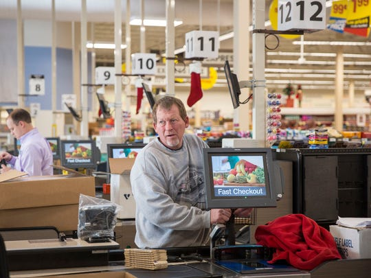 Workers continue to stock and set up Kroger's first