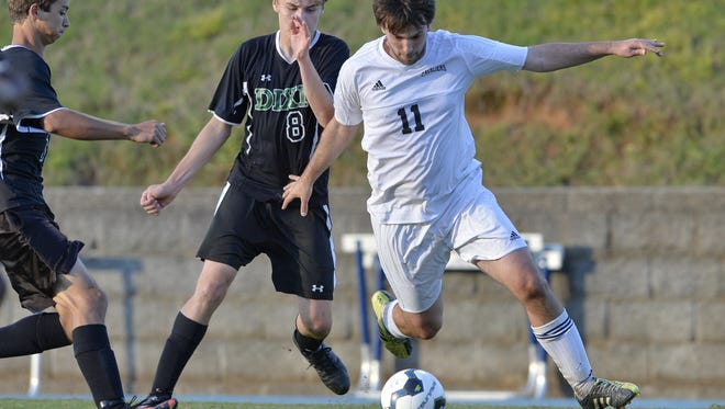 Christ Church's Legare Grimball (11) battles for the ball with Dixie's Owen Taylor (8). Grimball had a hat trick in the first half of the Cavaliers' 5-0 Class A second-round playoff victory Thursday night.