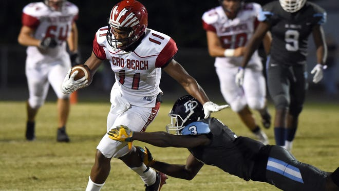 Vero Beach's Mike Smith (11) gets past Dr. Phillips defender D.J. Charles on Friday, Nov. 25, 2016, for a first down during their high school football Region 2-8A championship game at Dr. Phillips High School in Orlando. Dr. Phillips defeated Vero Beach 34-24.