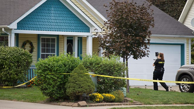 The scene of a double homicide at a residence on Soaring Eagle Court, on Indianapolis' west side, Thursday, Sept. 22, 2016.