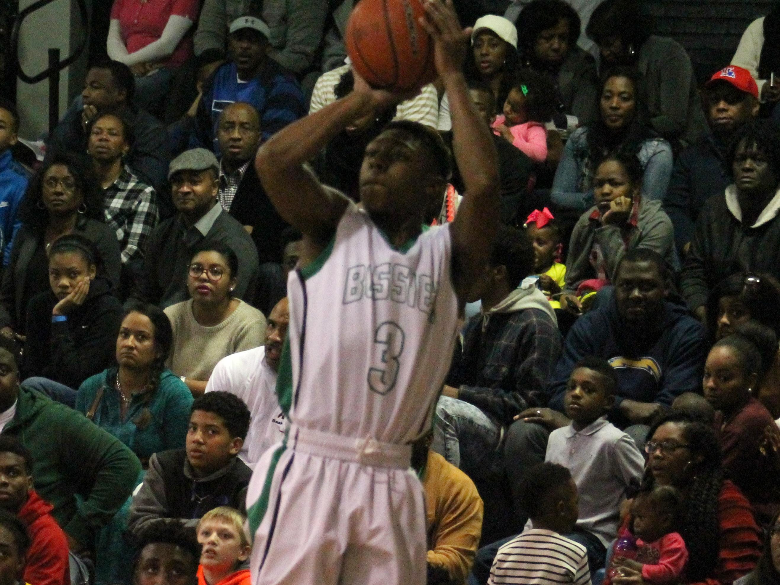 Bossier high School guard Larry Robinson(3) attempts the 3-point shot in a game earlier this season.