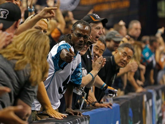 Rattlers fans celebrate against the Gladiators at Talking
