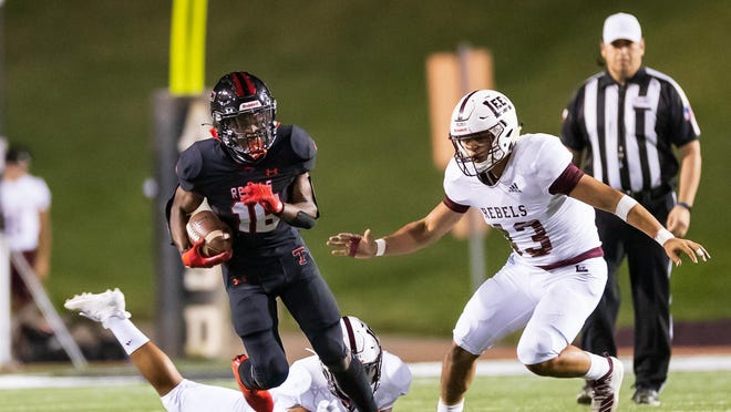 Tascosa running back Major Everhart heads upfield for yardage as Midland Lee's Martin Castaneda pursues during Friday night's game at Dick Bivins Stadium. Everhart ran for 126 yards and a touchdown but Lee won 31-21.