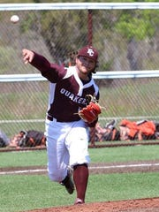 Earlham College freshman Walter Talcott throws to first base.