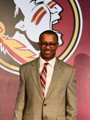 FSU head coach Willie Taggart speaks at his first press conference inside Doak Campbell Stadium.