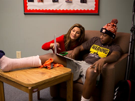 "Brittany Wagner, a Clinton native, mentors East Mississippi Community College football player Malik Mayweather during a scene in ""Last Chance U,"" a six-part documentary about the school's football program."