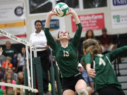 Lincoln's Loren Scott sets the ball against Chiles during their match at Lincoln High School on Wednesday, Aug. 30, 2017.