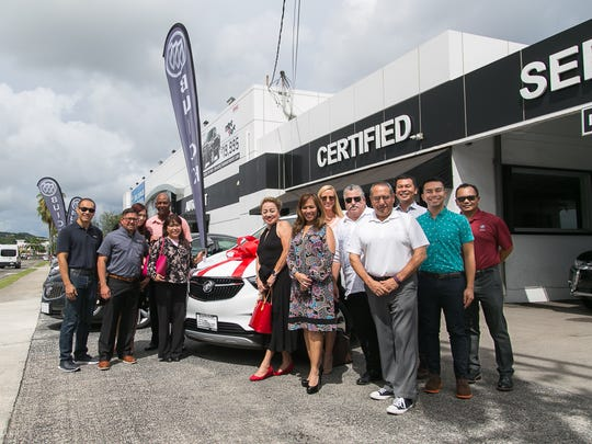 "Guam AutoSpot presents Lisa Balbin with a 2017 Buick Encore at the Guam AutoSpot Showroom on Oct. 2. Balbin won as the 2017 Buick Encore as the grand prize from the American Red Cross Guam Chapter's 17th Annual ""101 Reasons"" Red Ball on Sept. 23. Pictured (from left) Marcos W. Fong, Chairman of the Board, ARC; Derrick Muna Quinata, President, Guam AutoSpot; Sandra Ramiro, Service to Armed Forces Director, ARC; Joseph Foster, Volunteer, ARC; Balbin; Chita Blaise, Chief Executive Officer, ARC; Caroline Sablan, Board Member, ARC; Holly Butler, Intern, ARC; Robert Marks, Board Member, ARC; Paul Baron, Board Member, ARC; Danny Daniel, Brand Manager, DOCOMO PACIFIC; Ken Quintanilla, Public Relations Coordinator, DOCOMO PACIFIC; and Sammy Sotelo, Business Development and Marketing Director, Guam AutoSpot. (Photo courtesy of Guam AutoSpot)"