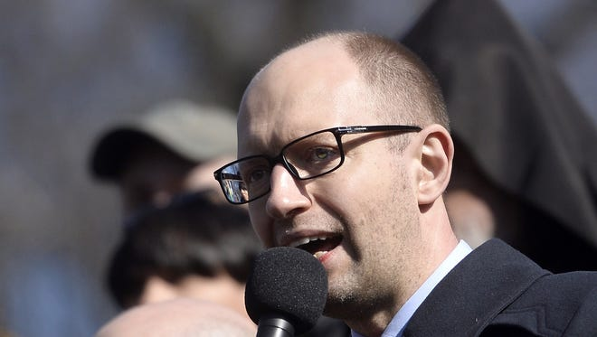Ukrainian Prime Minister Arseniy Yatsenyuk speaks during a rally to commemorate the 200th anniversary of poet and national icon Taras Shevchenko at Independence Square in central Kiev on March 9, 2014.