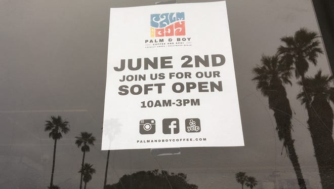 A sign announces the soft opening of Palm & Boy Coffee and Acai in Oxnard's Hollywood Beach neighborhood. The coffeehouse also has a site in downtown Ventura.