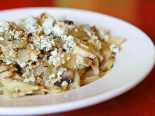 Cafe Lou Lou's pasta dishes include a blue cheese artichoke chicken pasta with a white wine thyme cream sauce.