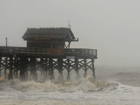 Big waves churned by Matthew lash the Cocoa Beach Pier