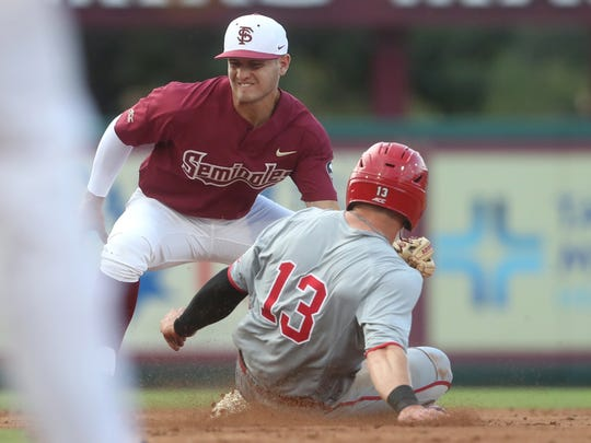 N.C. State's Brock Deatherage slides in safely at second base under the tag FSU's Mike Salvatore during their game at Dick Howser Stadium on Friday, May 18, 2018.