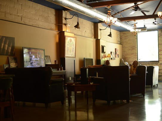 Customers sit inside the Prohibition Spirits and Cigar