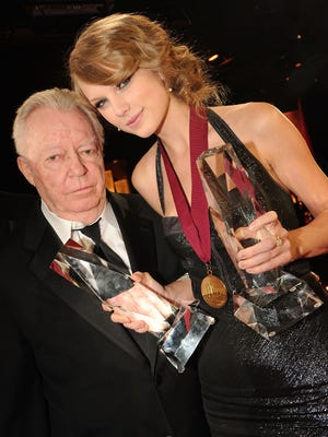 BMI Icon Billy Sherrill and Taylor Swift with her awards for BMI Songwriter of the Year and Co Writer of BMI Song of the Year at the 58th Annual BMI Country Music Awards at BMI on November 9, 2010 in Nashville, Tennessee.